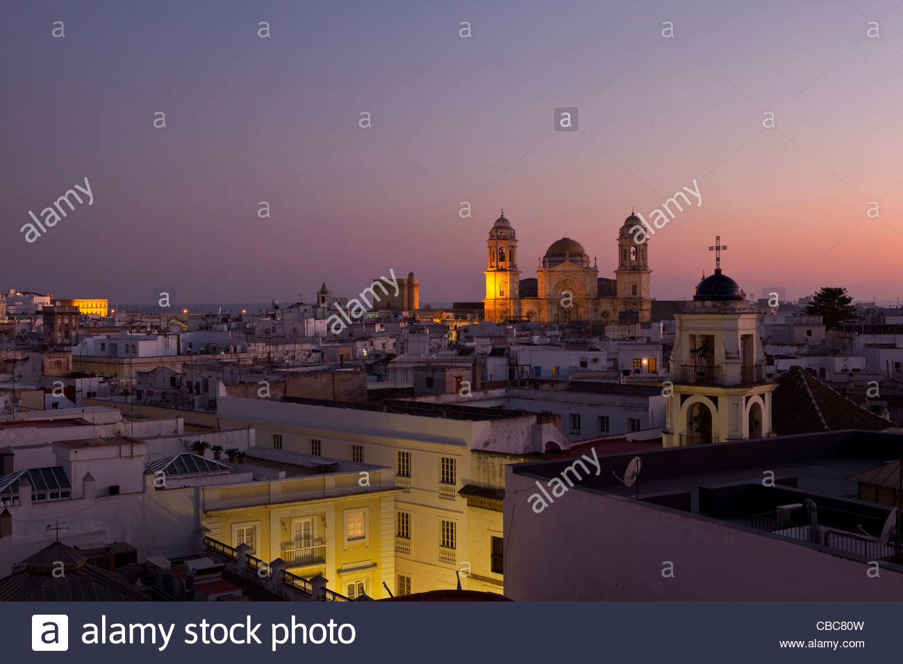 Aerial view of village rooftops at night - Stock Image