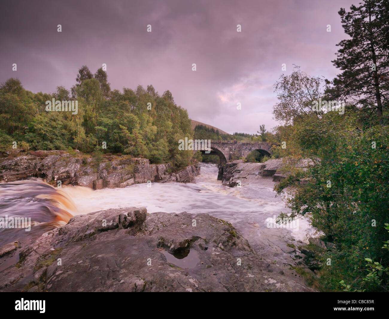 River rushing over boulders - Stock Image