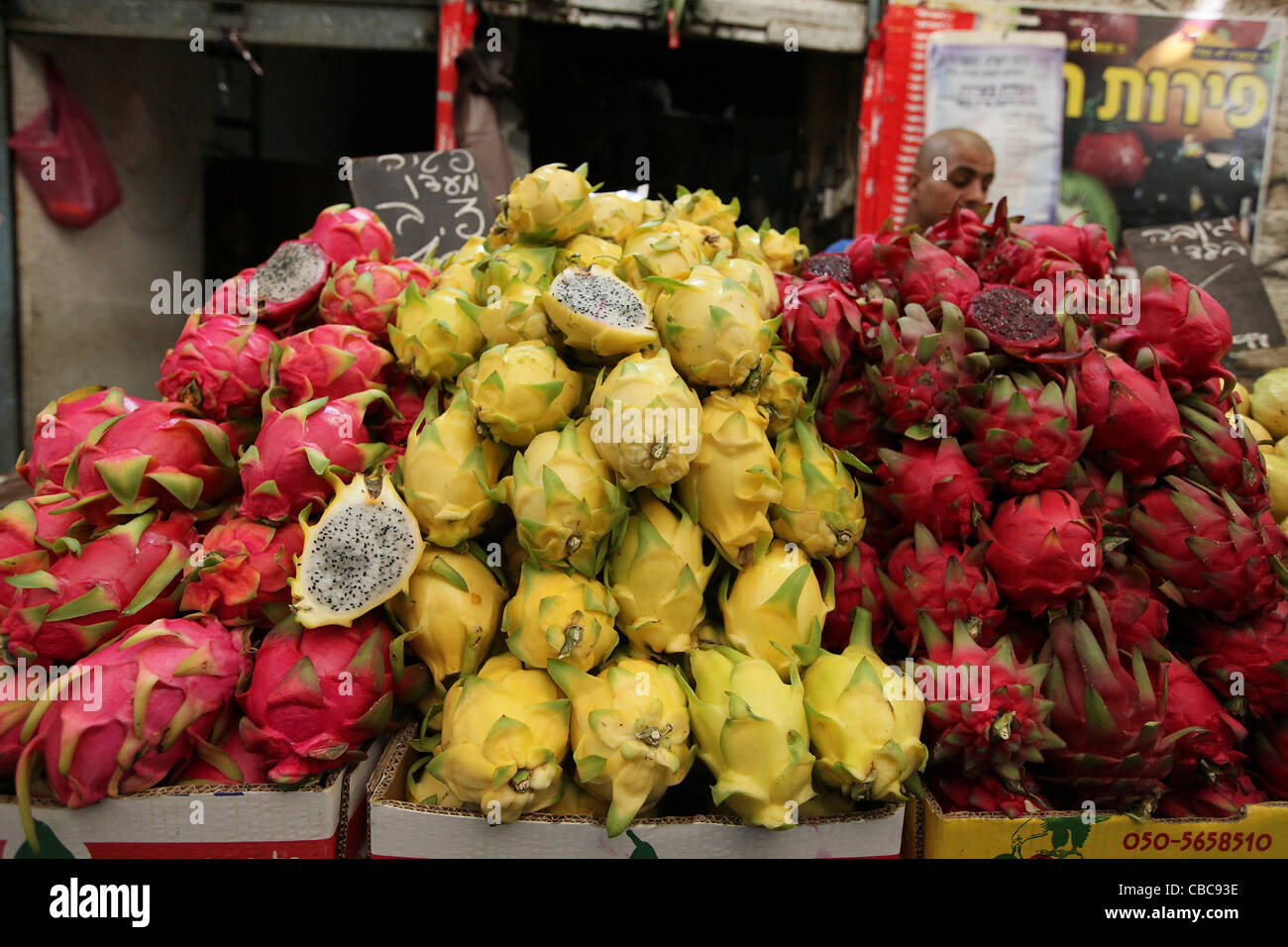 A market stall selling yellow and red pitaya - Stock Image