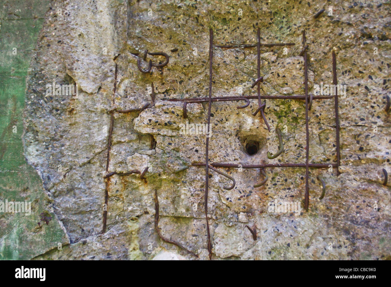 The Miedzyrzecz Fortification Region. Close-up of a bullet hole in reinforced concrete wall of bunker. - Stock Image