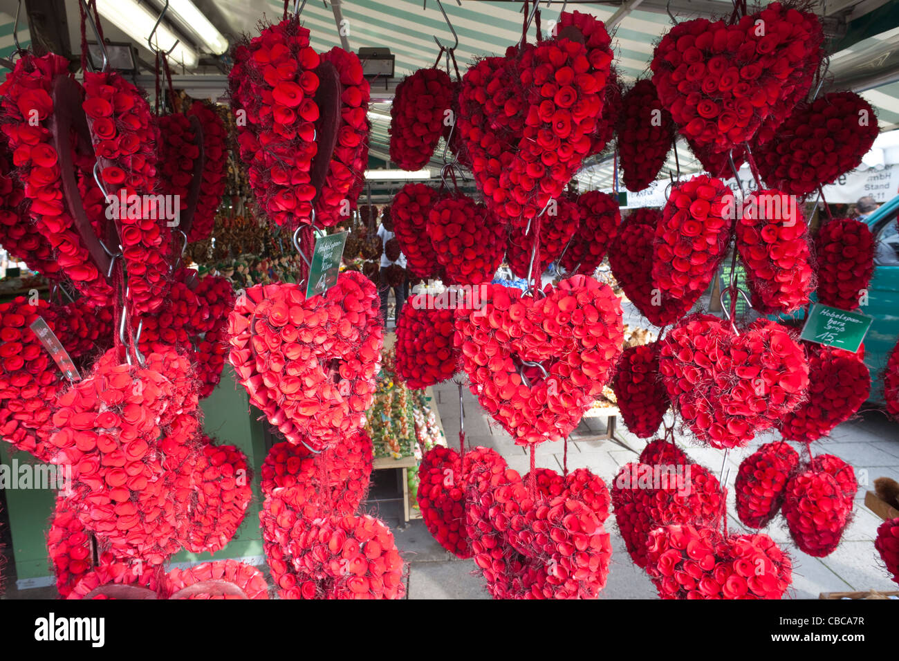 Germany, Bavaria, Munich, Viktualienmarkt, Heart Shaped Floral Display - Stock Image