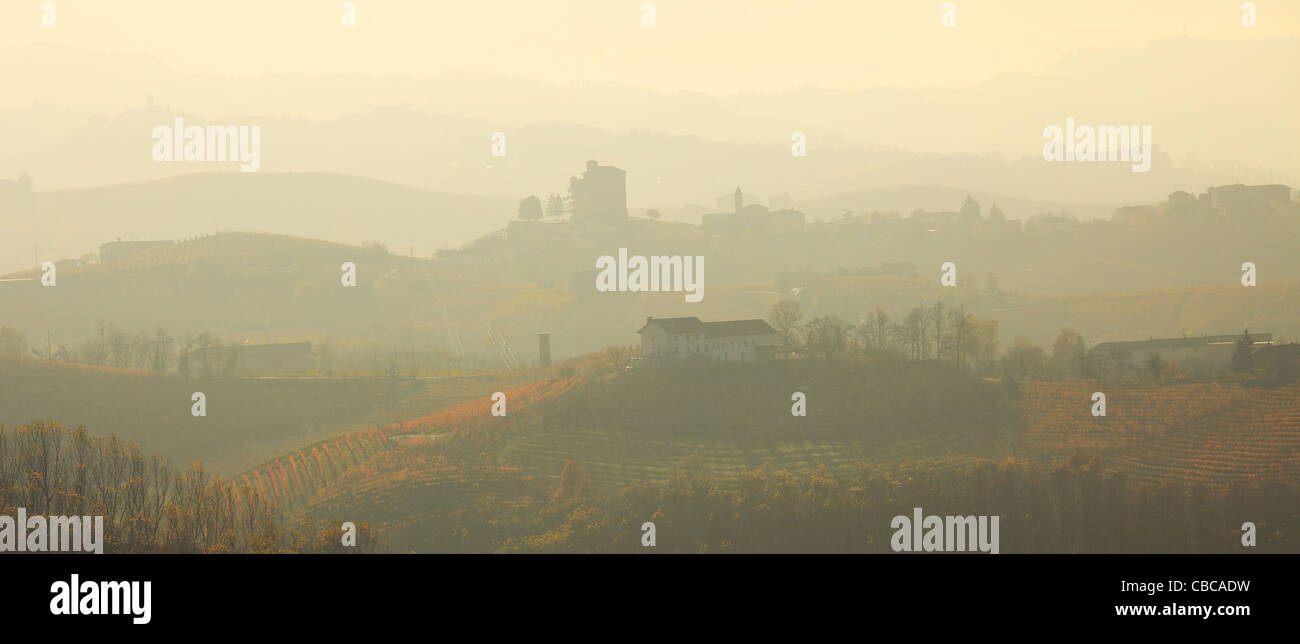 Panoramic view on hills covered by morning haze in Piedmont, Northern Italy. - Stock Image