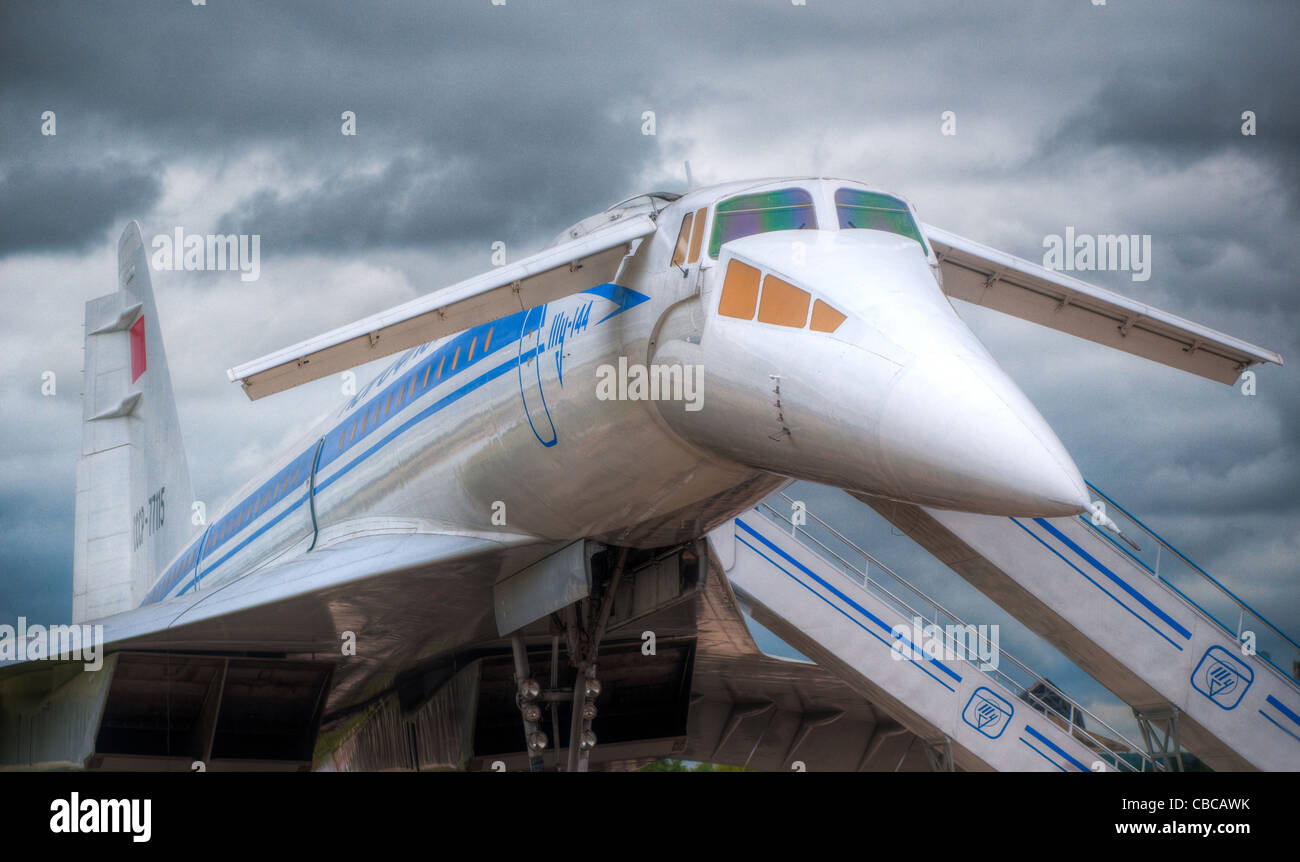 supersonic jet plane on the ground boarding with dramatic sky in background - Stock Image
