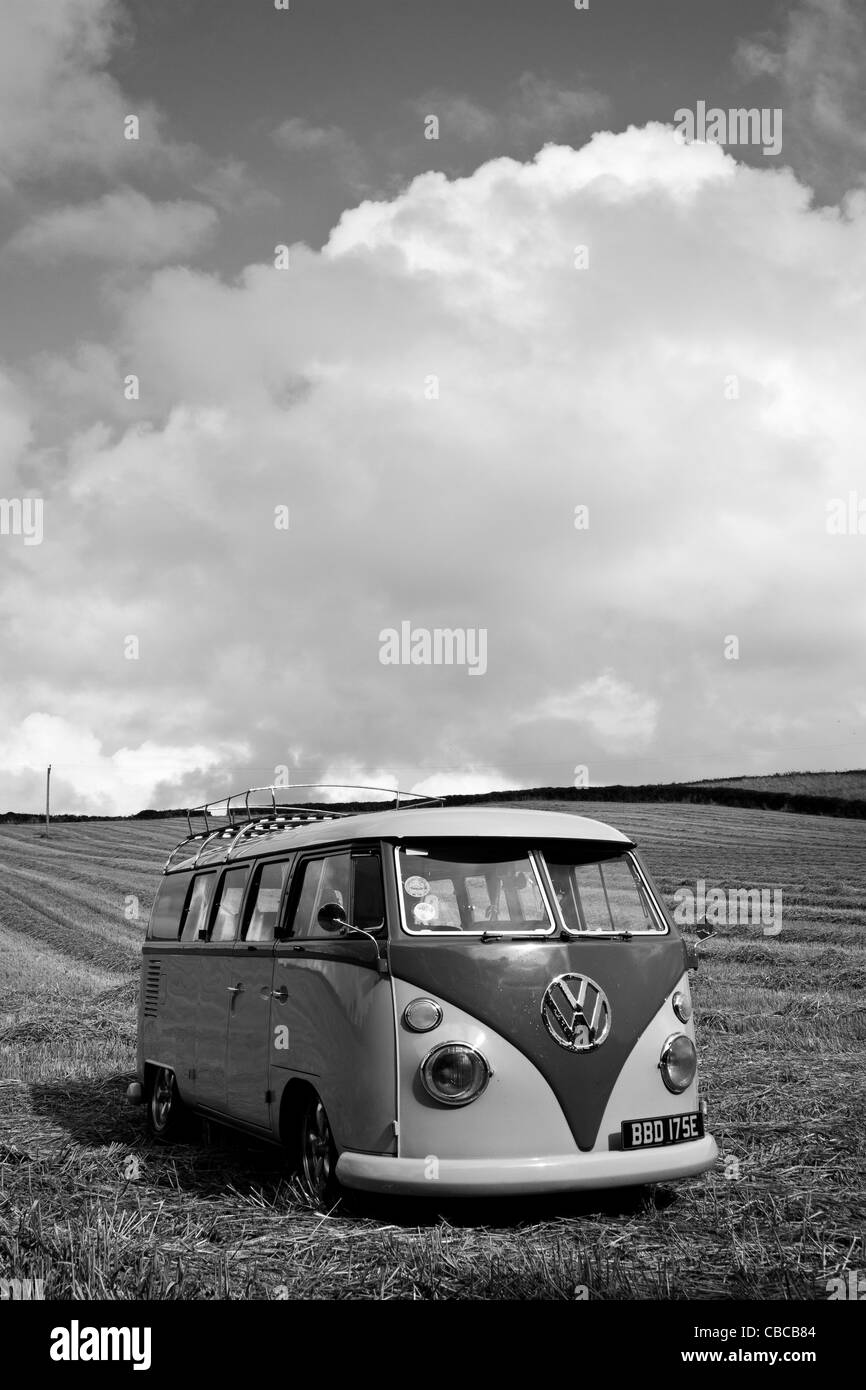 A lowered 1966 Split Screen VW Campervan, taken in a cornfield in Cornwall on a sunny day.  Converted to black and - Stock Image