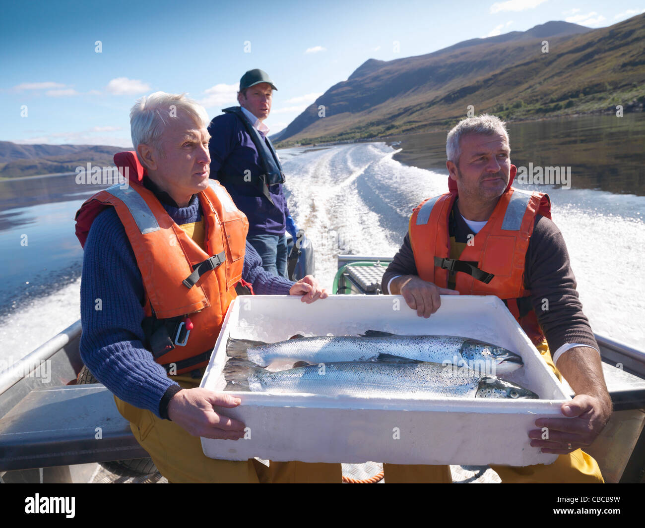 Fishermen with catch of the day on boat - Stock Image