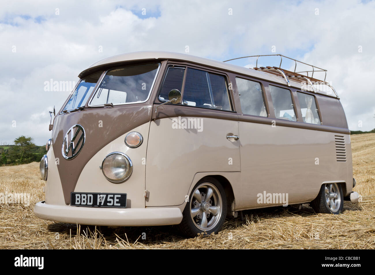 A lowered 1966 Split Screen VW Campervan, taken in a cornfield in Cornwall on a sunny day - Stock Image