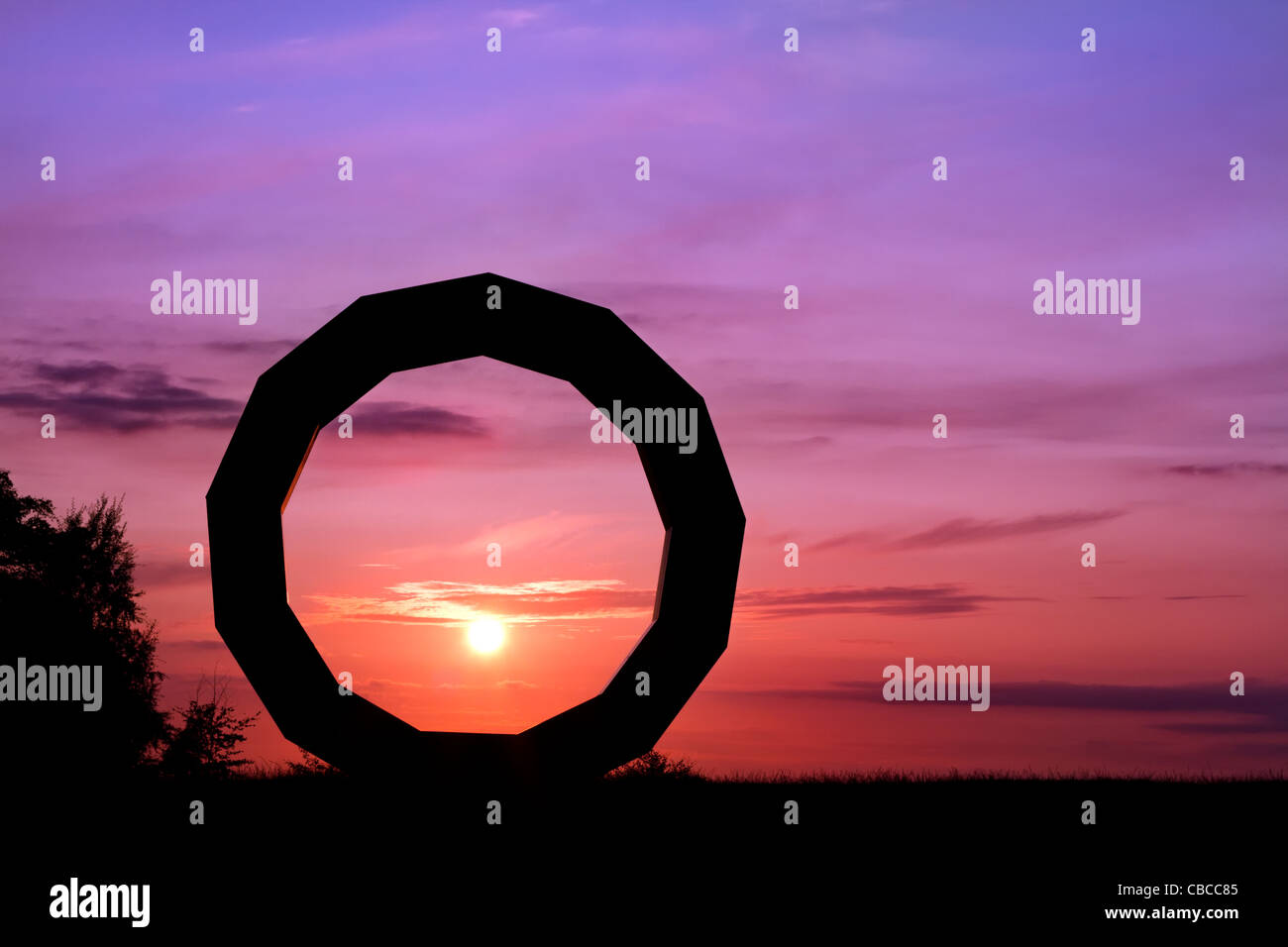 SUNSET SILHOUETTE image of granite sculpture known as Heavens Gate, part of the Longleat Estate, Wiltshire - Stock Image