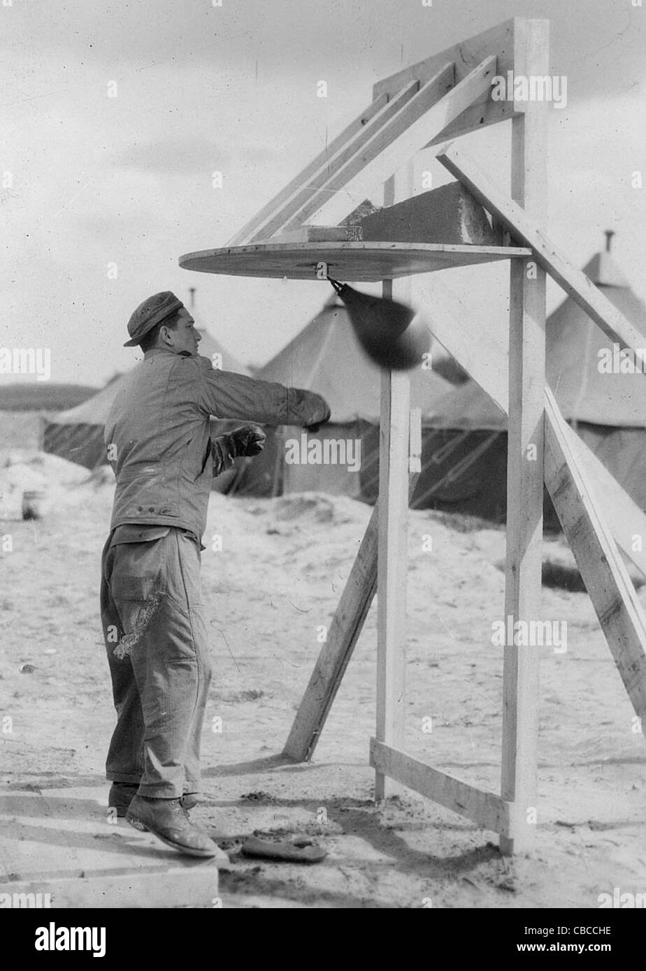 A US Airman boxes to relax during WW11. - Stock Image