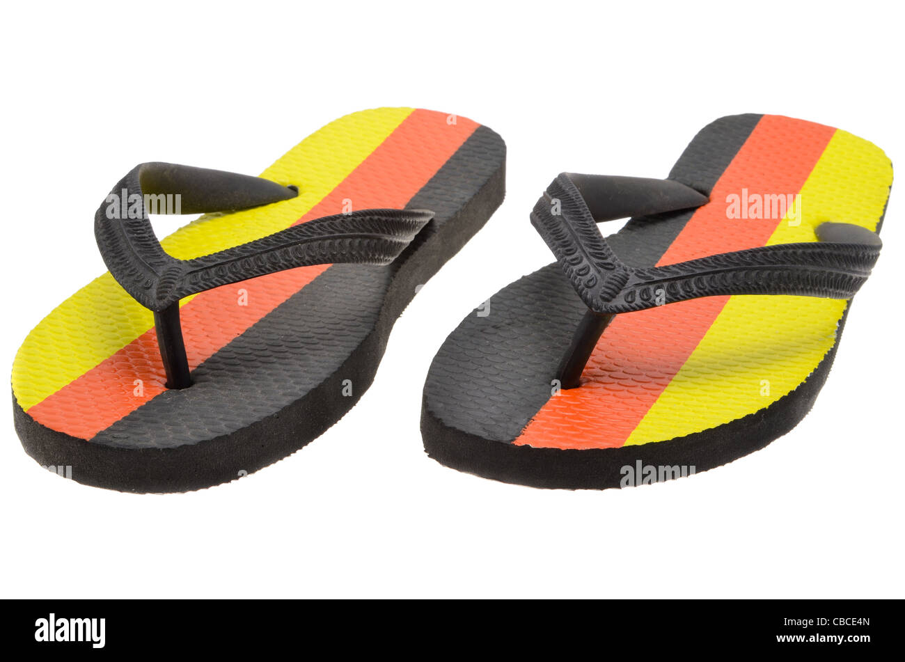 A pair of flip-flops printed with the colours of the national flag of Germany. - Stock Image