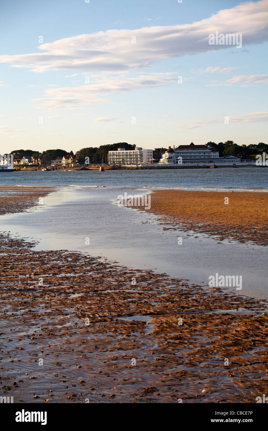Tide out at Studland beach with views across to houses and Haven Hotel at Sandbanks, Poole in August - Stock Image