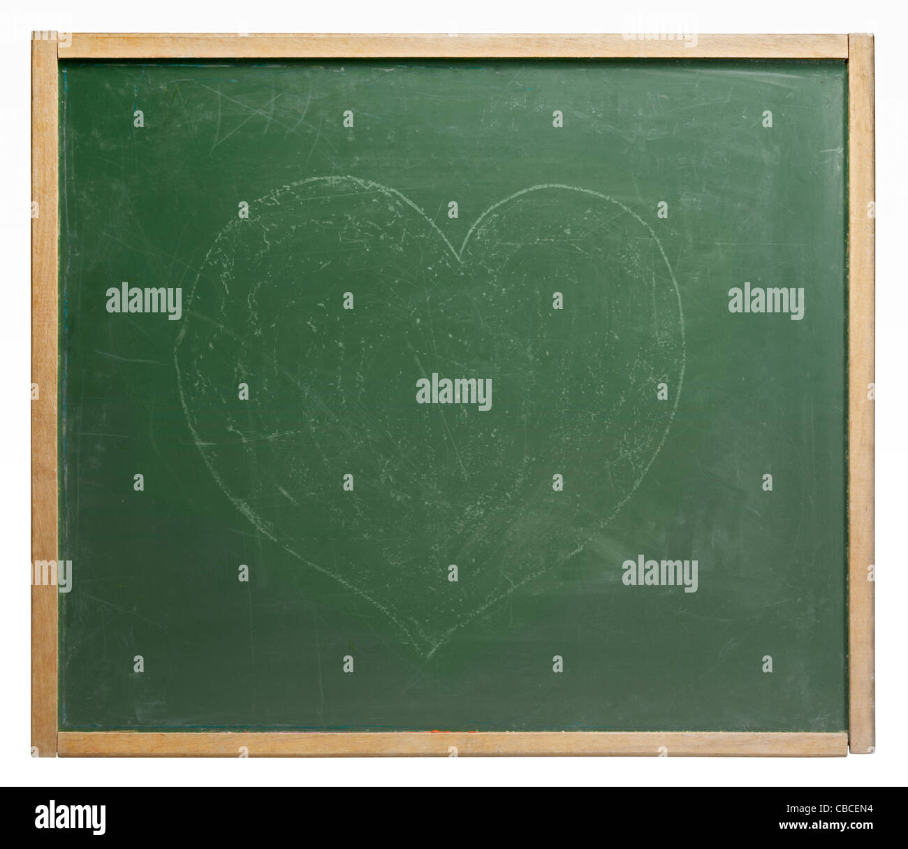 old used blackboard with unobtrusive painted heart shape on it. Studio photography in white back Stock Photo