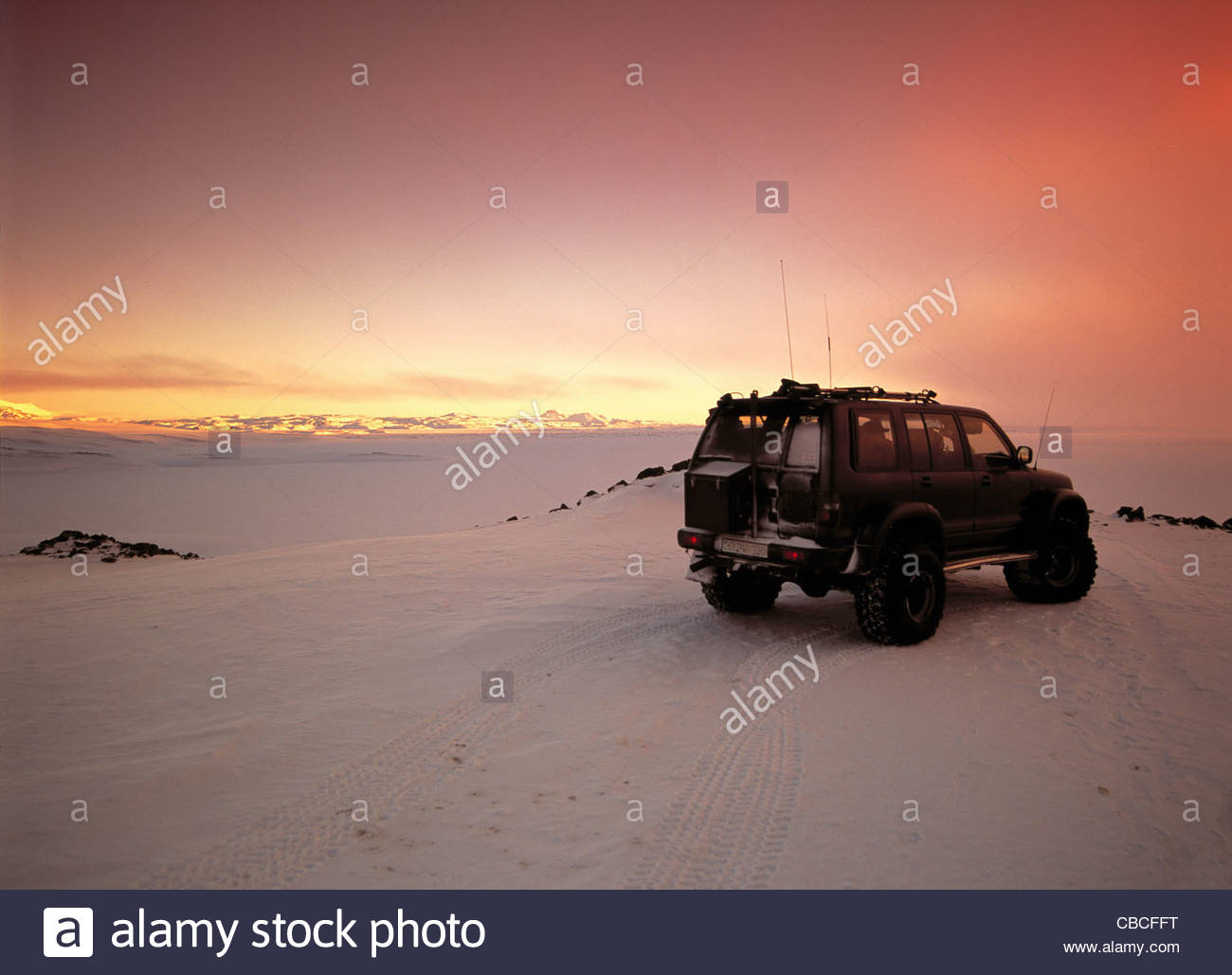ATV parked in snowy terrain - Stock Image