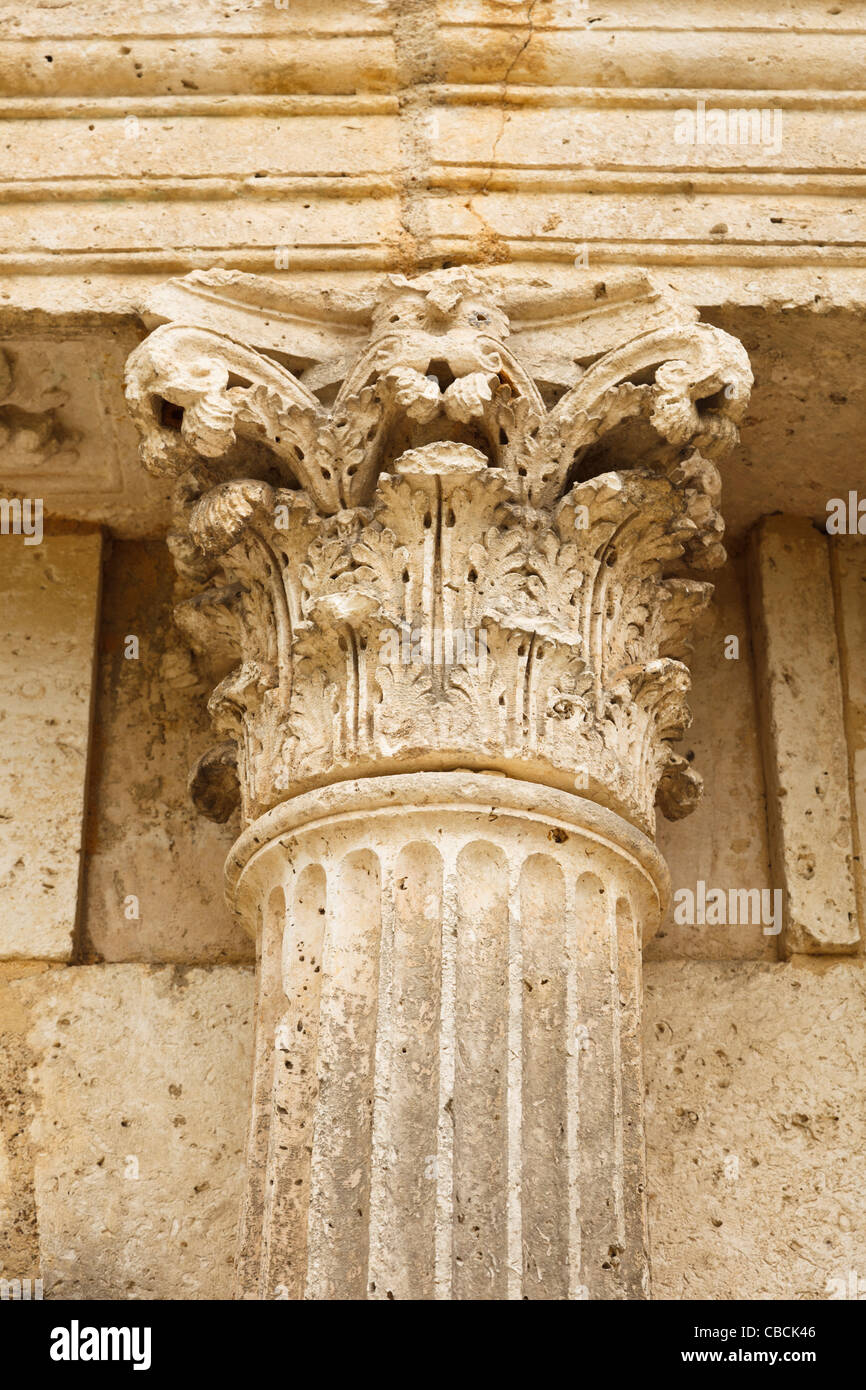 Corinthian column with decorated capital or head - Stock Image