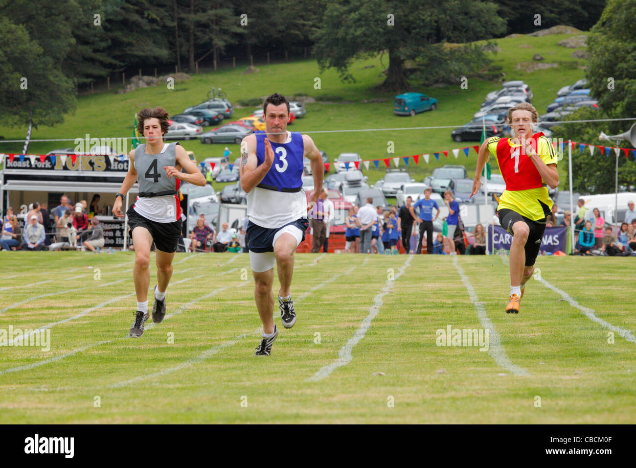 Athletes racing at Ambleside Sports, The Lake District, Cumbria, England, UK - Stock Image