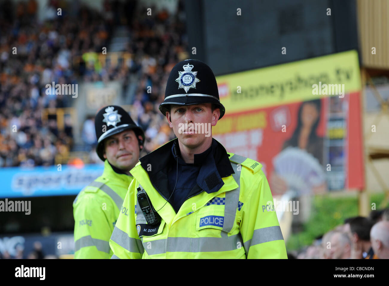 Male police officers at football match Uk - Stock Image