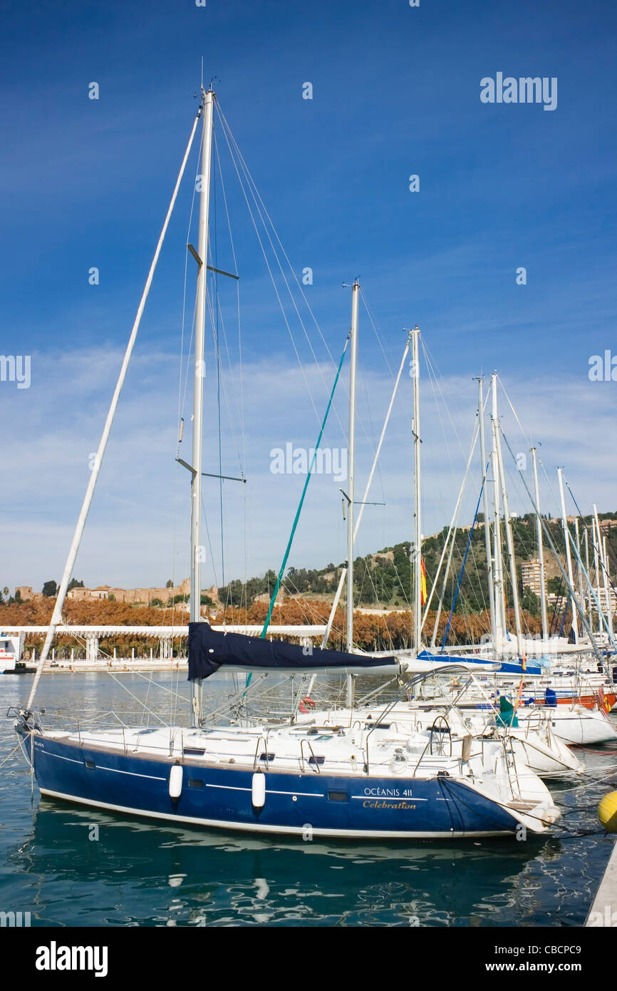 Moored yachts in the newly renovated port of Malaga, Costa del Sol, Andalucia, Spain. - Stock Image