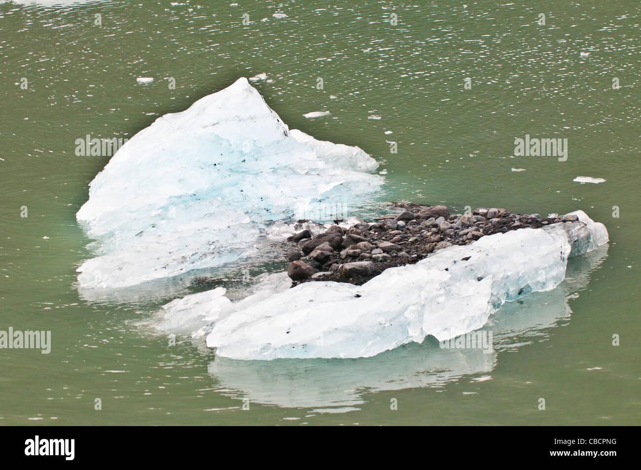 Ice berg carrying glacial gravel, Holgate Arm, Kenai Fjords National Park, Seward, Alaska - Stock Image
