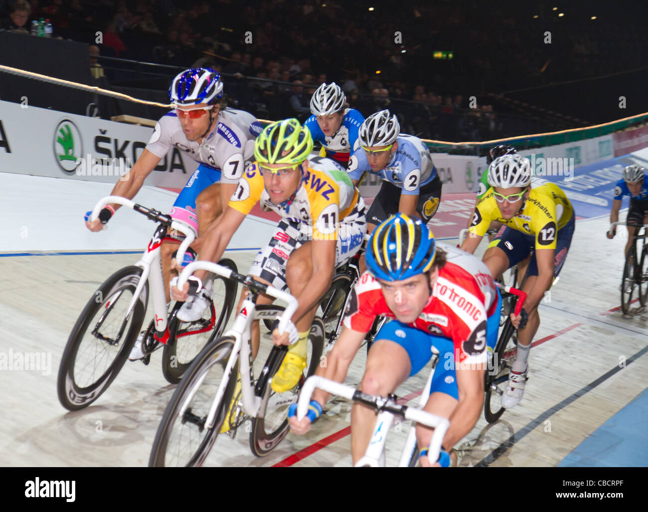 athletes fight for victory at indoor bike challenge Sixday-Nights Zürich 2011 at Zurich Hallenstadion - Stock Image