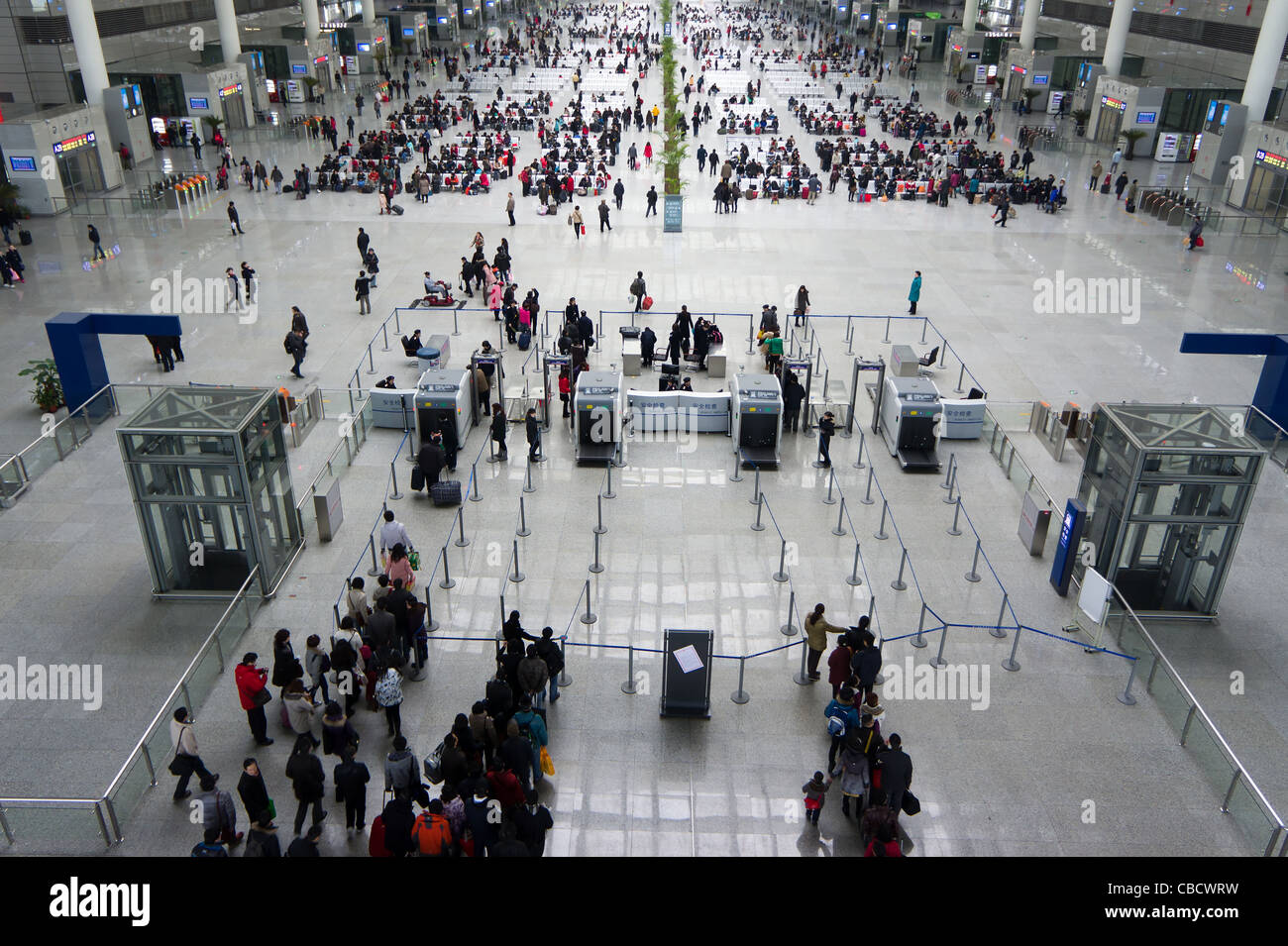 Security gate and waiting room for high speed trains at the Shanghai Hongqiao Railway Station, China - Stock Image