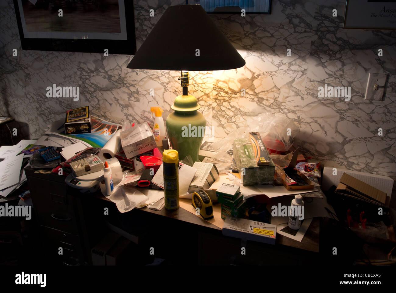 Very messy desk. - Stock Image
