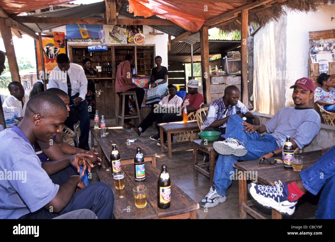 Truck drivers drinking beer in a bar at border to Malawi in Songwe Tanznania - Stock Image