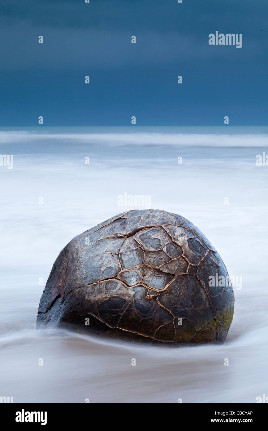 Single boulder at Moeraki Boulders Otago New Zealand - Stock Image