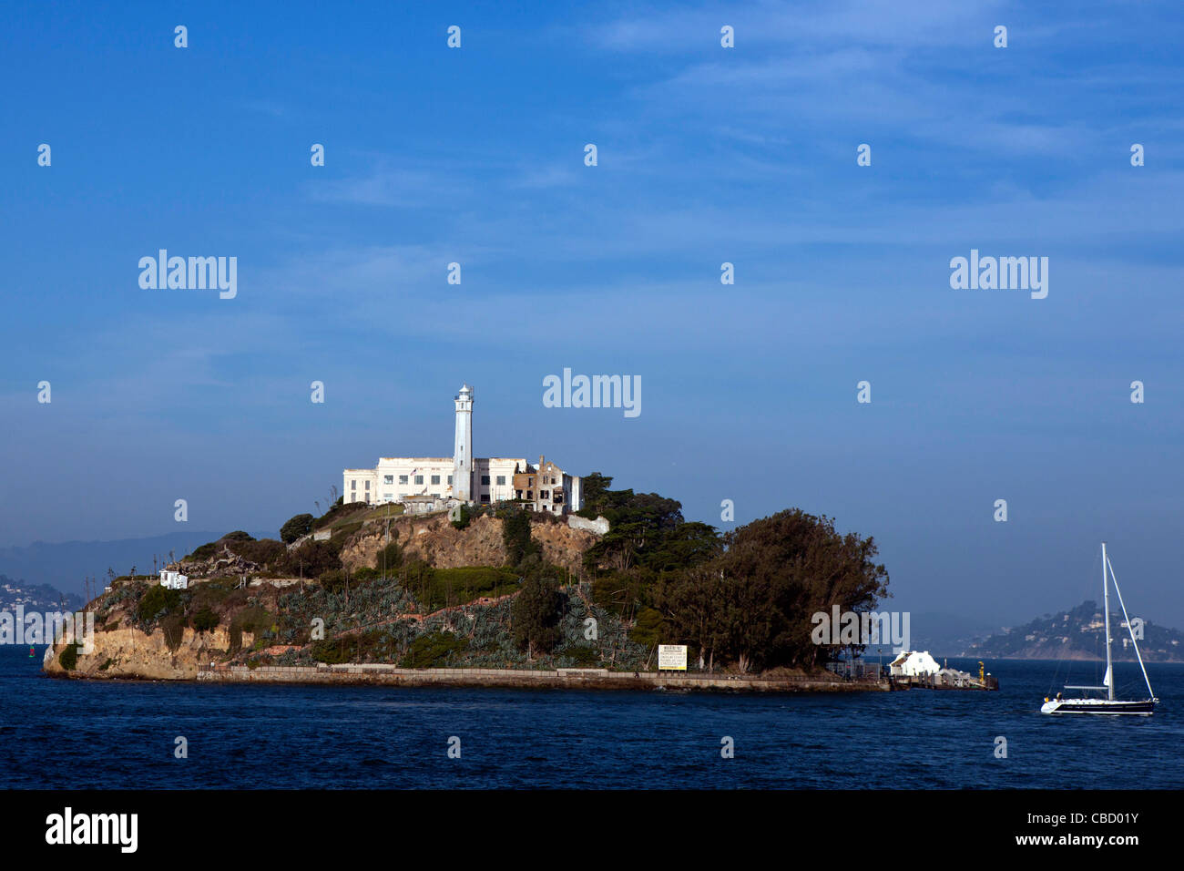 Alcatraz Island with sailboat passing by, San Francisco, California, United States of America - Stock Image