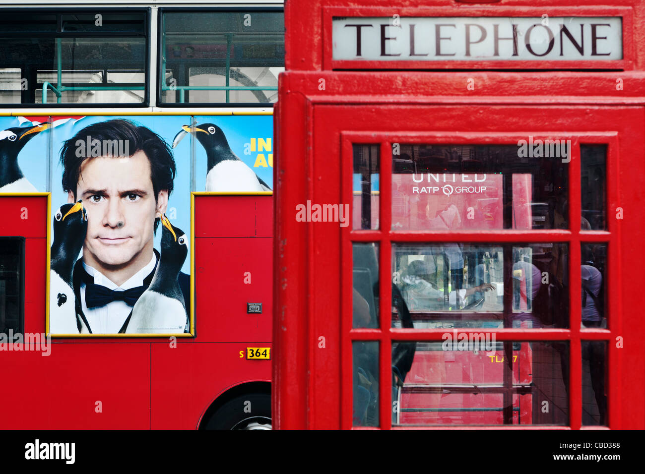 Red Bus and Telephone Box London England - Stock Image
