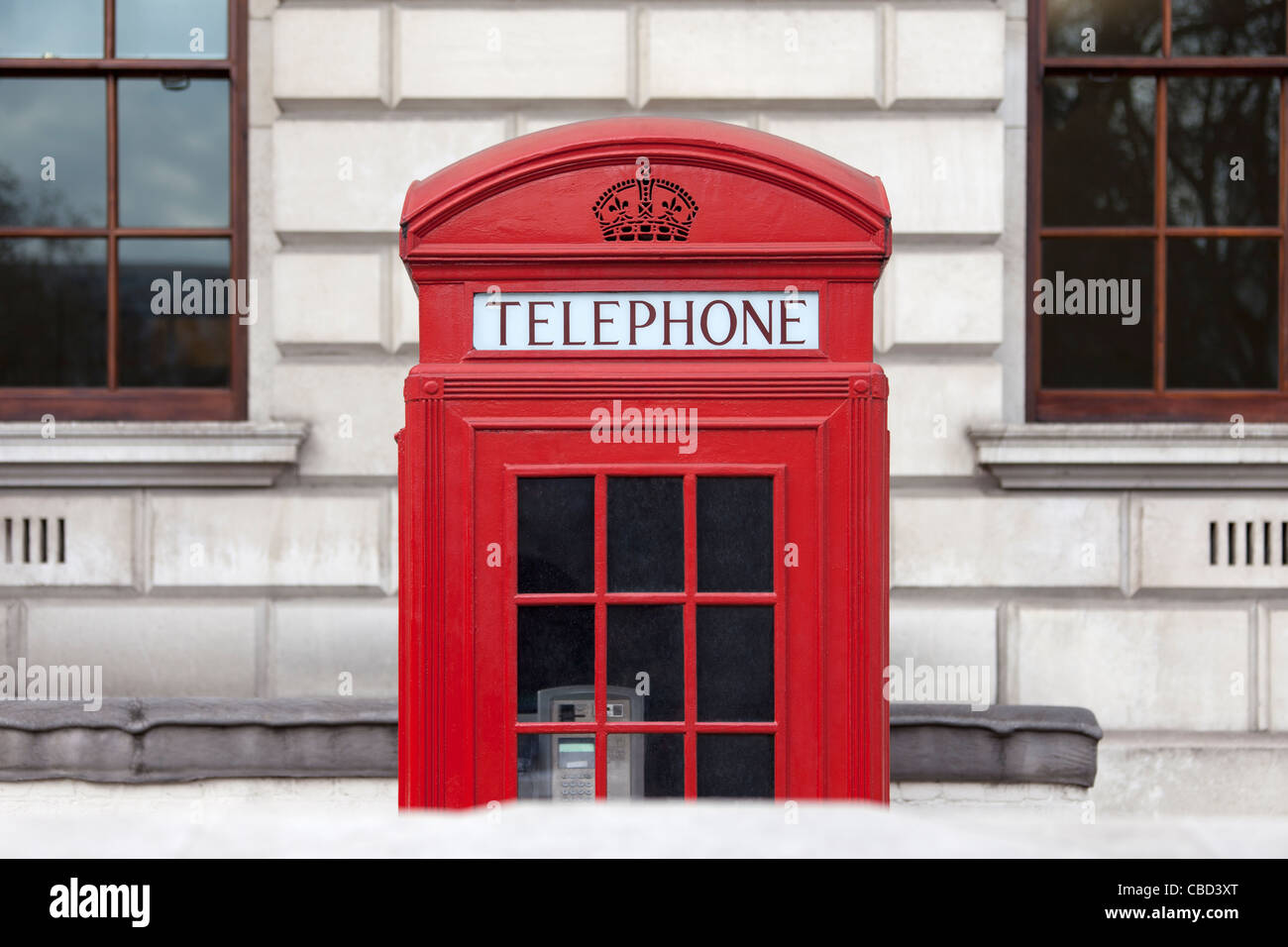 Red telephone box on city street - Stock Image