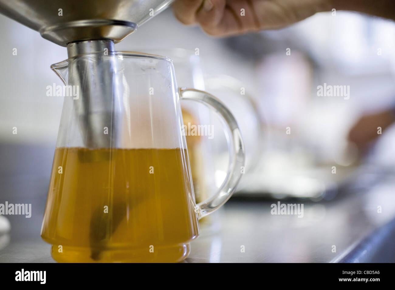 Preparing pitcher of tea - Stock Image