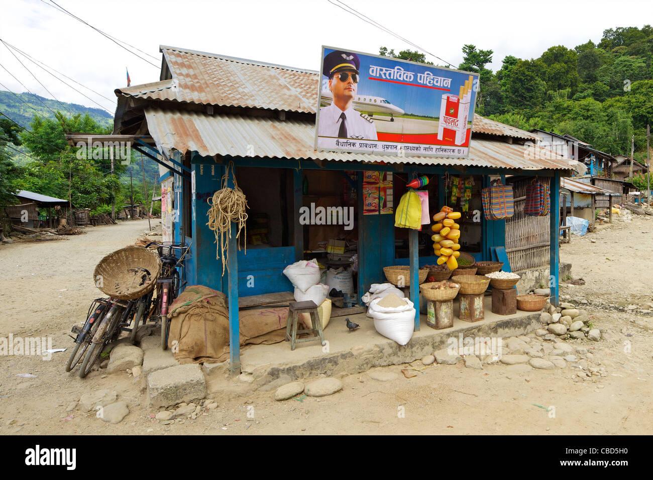 Cigarette advertisement, airline pilot, shop front, Chatara town, Terai, Nepal, Asia - Stock Image