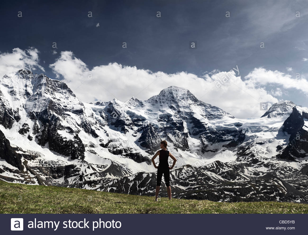 Woman overlooking glacial landscape - Stock Image