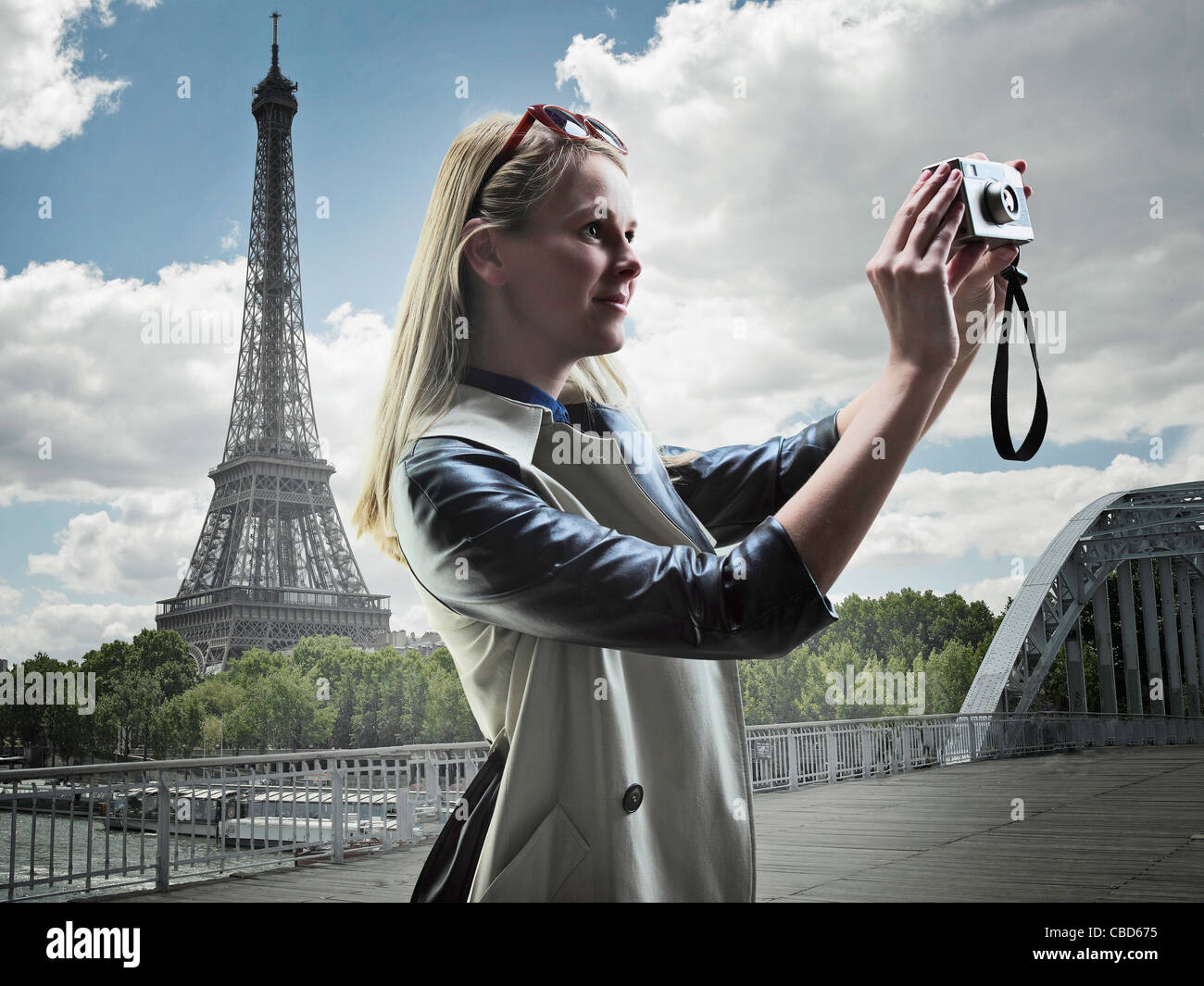 Woman taking pictures in Paris Stock Photo