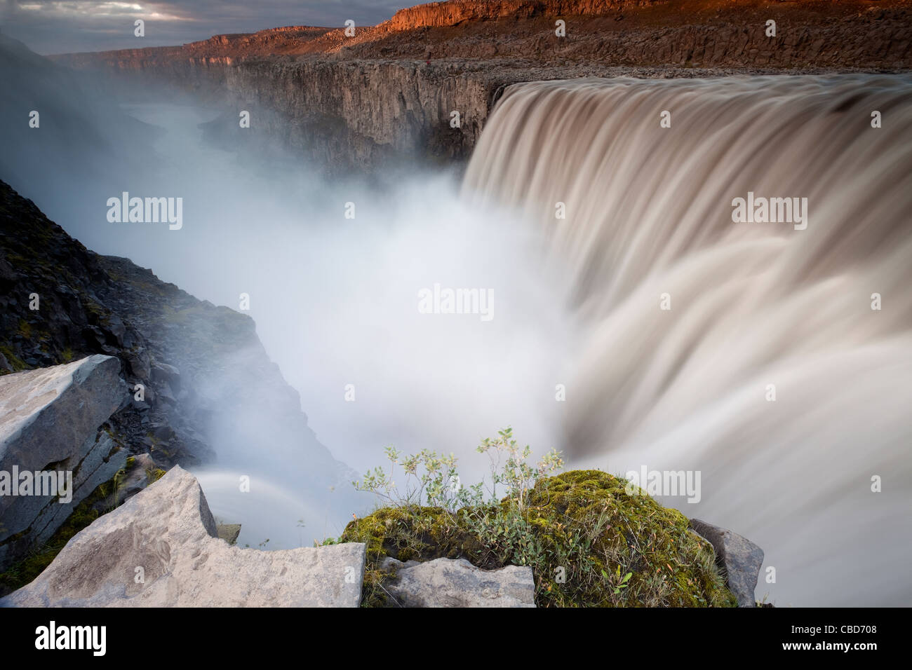 Waterfall over rural landscape - Stock Image