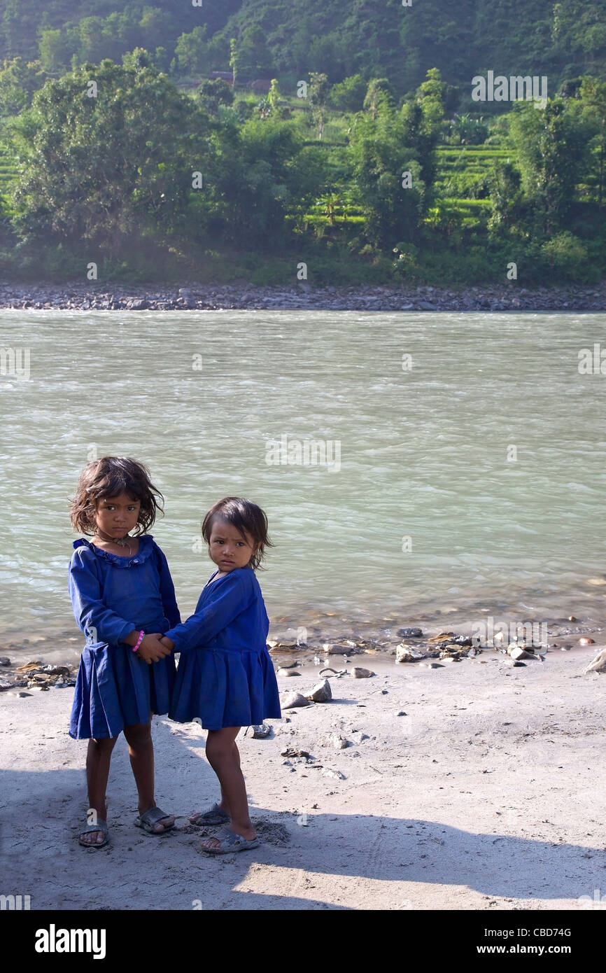 Local Nepali children on Sun Kosi river, Nepal, Asia - Stock Image