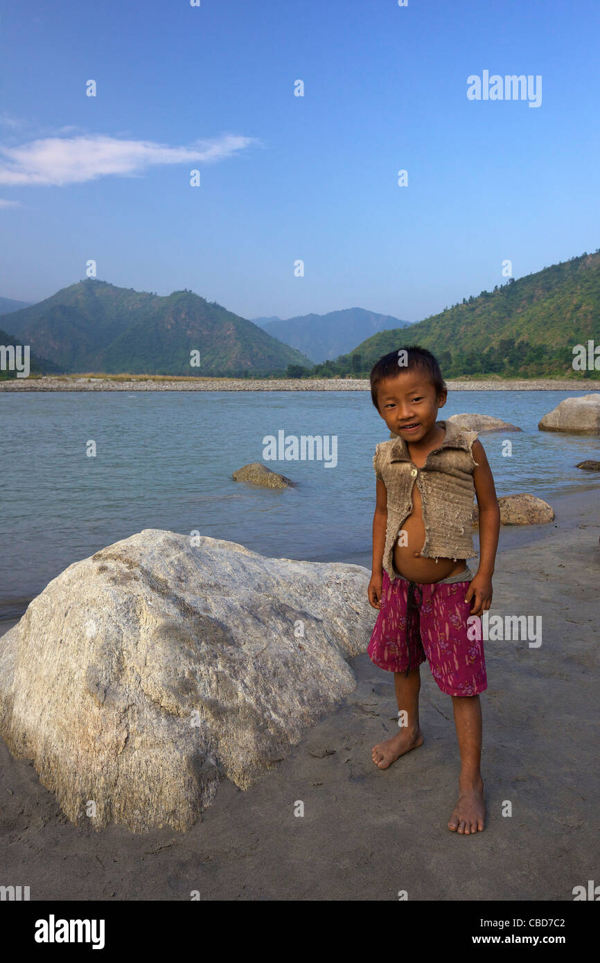 Local Nepali child on Sun Kosi river, Nepal, Asia - Stock Image