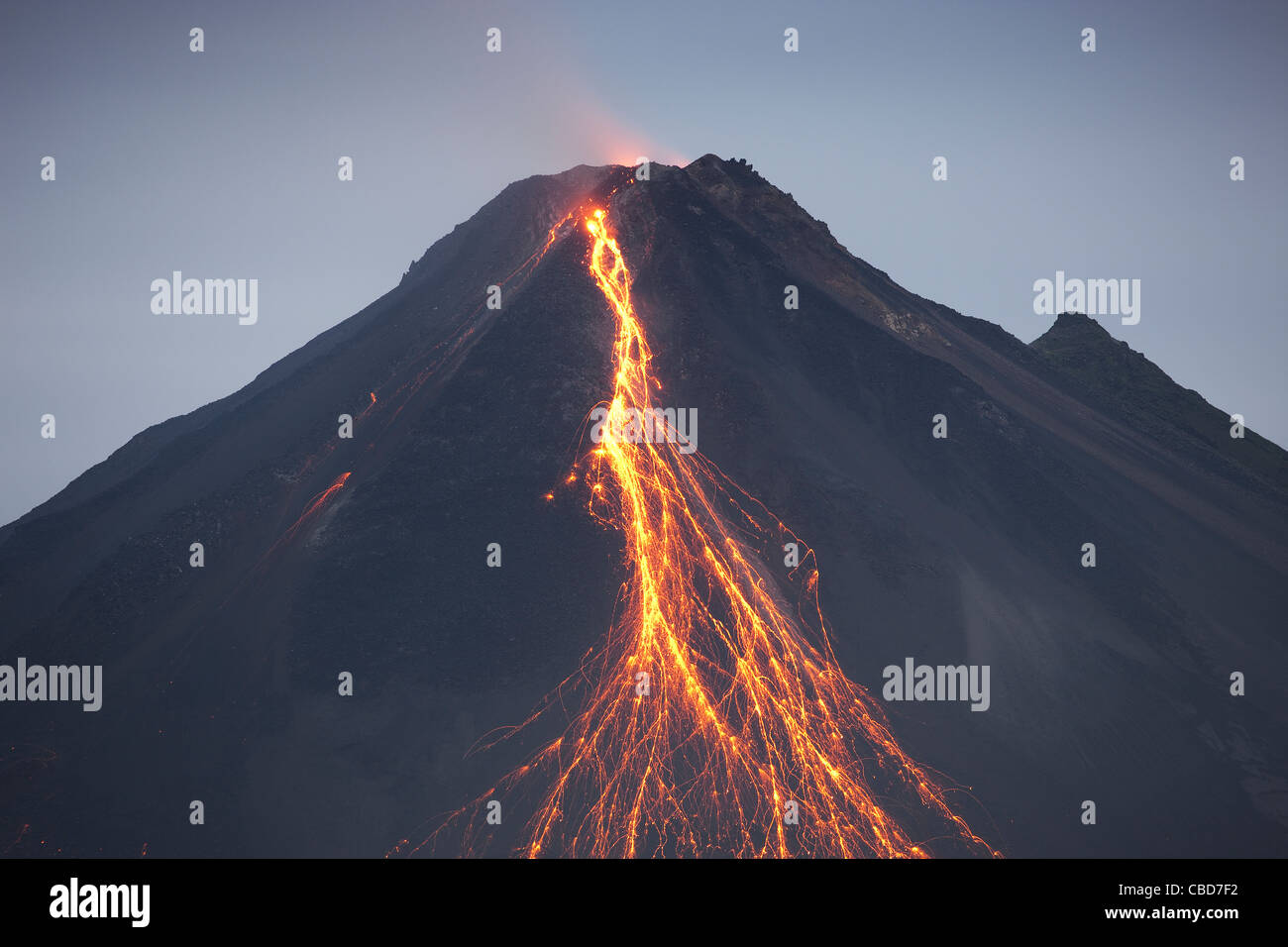 Lava pouring out of volcano - Stock Image