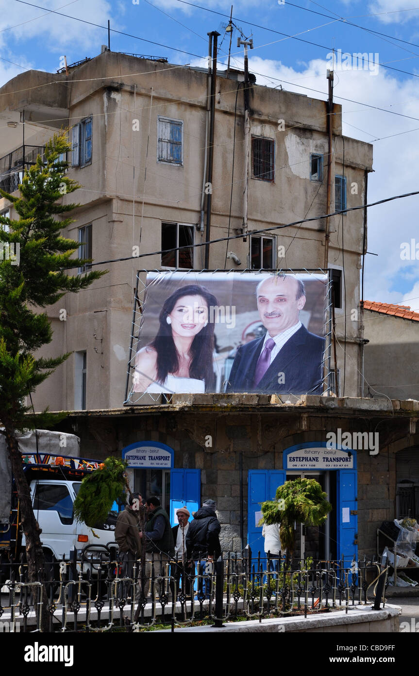 Bcharre, birthplace of Khalil Gibran. Billboard shows Samir Geagea, Lebanese Forces leader with his wife Setrida, - Stock Image