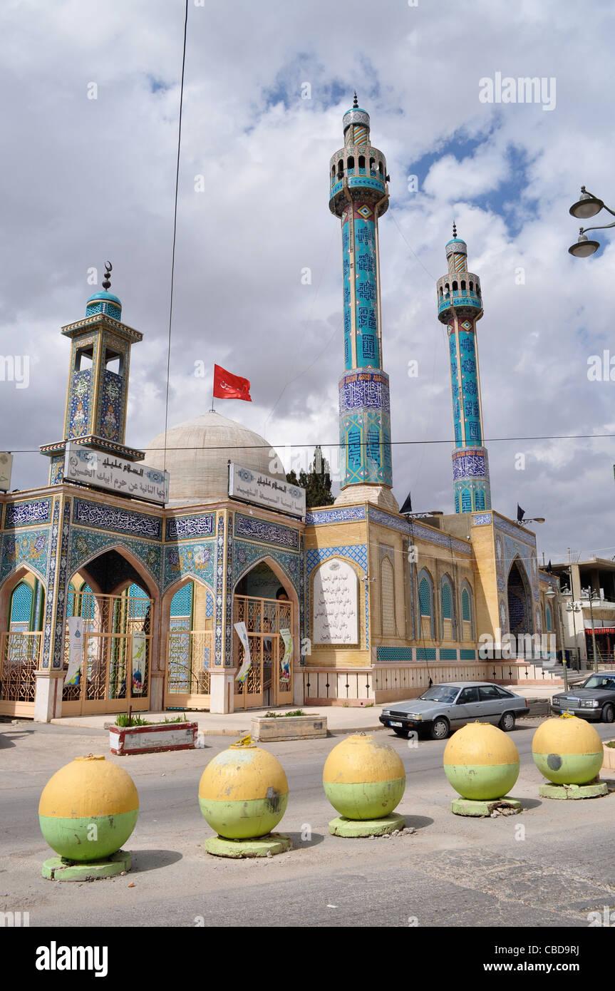 Shi'a shrine of daughter of Imam Hussain, Sayeeda Khawla, Hezbollah heartland, colours, flag, bomb blocks, Lebanon - Stock Image