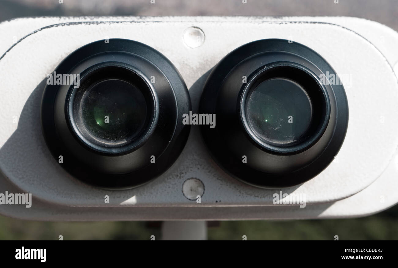 Binoculars overlooking the city of Barcelona from the Tibidabo amusement park observation point - Stock Image