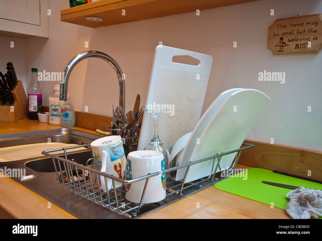 Kitchen Sink And Draining Board With Washing Up - Stock Image