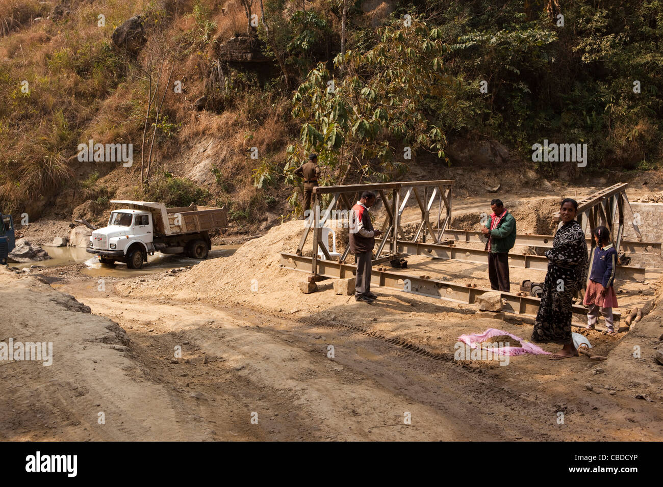 India, Nagaland, Khonoma, truck fording river where bridge being constructed - Stock Image