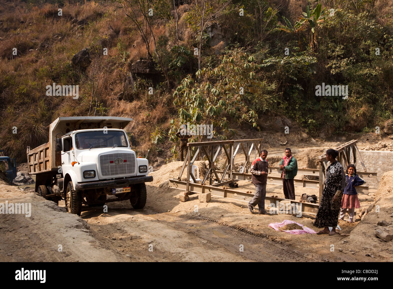 India, Nagaland, Khonoma, tata truck rising from river ford where bridge is being constructed - Stock Image