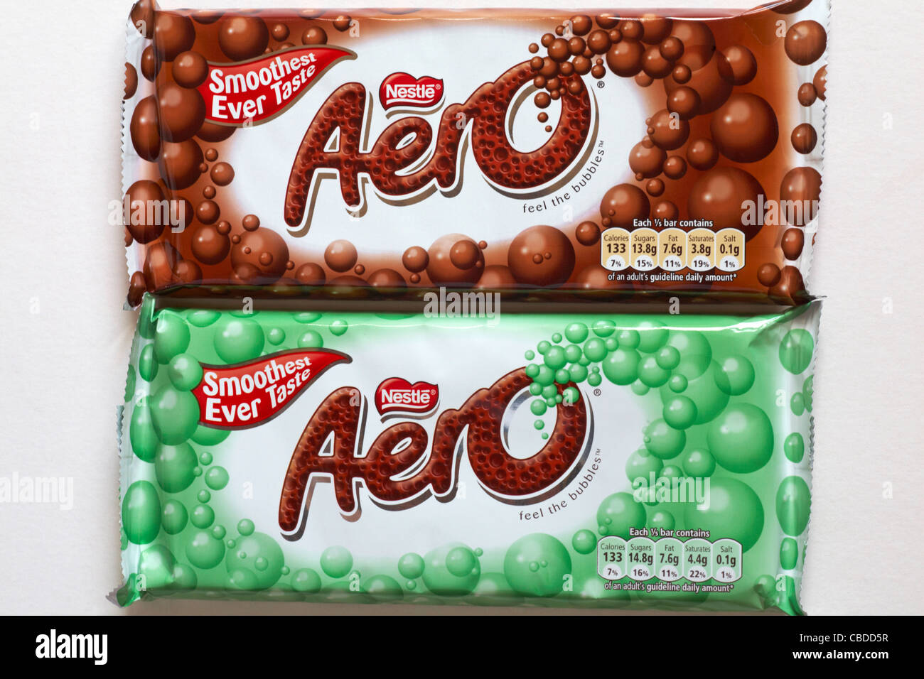 Two bars of Nestle Aero chocolate bars - one chocolate, one mint set against while background - Stock Image