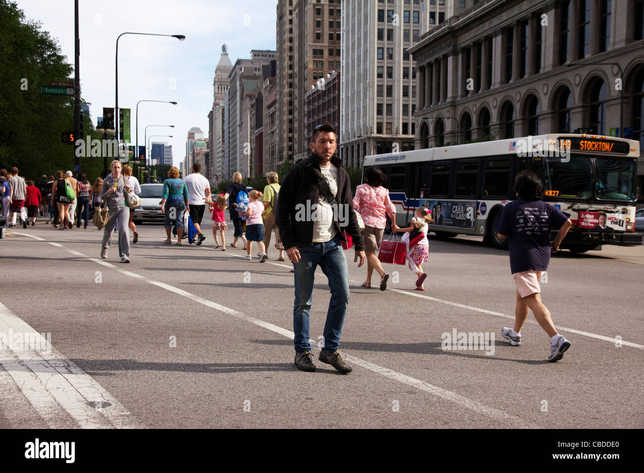Pedestrians crossing Randolph Street at Michigan Chicago Illinois - Stock Image