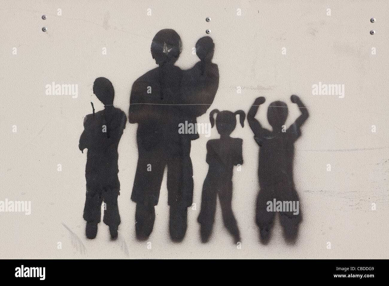 Stencil graffiti of a family - Stock Image