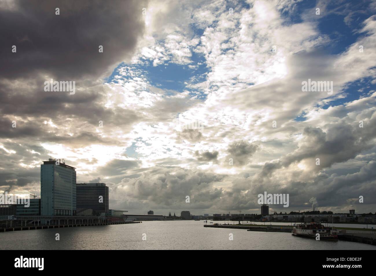 IJ harbour Amsterdam with heavy clouds, Het IJ. - Stock Image