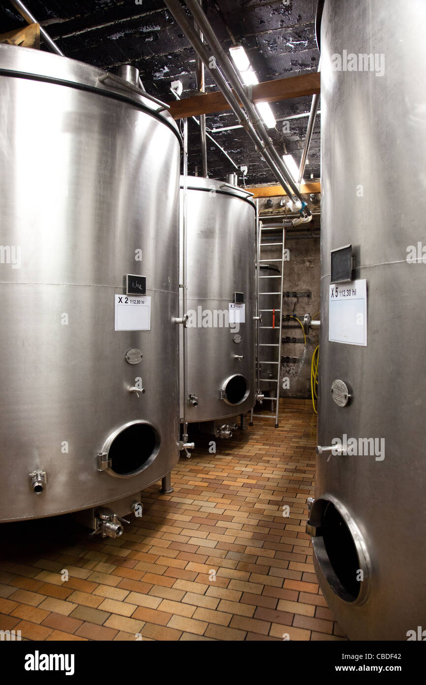 Stainless steel wine vats at Hugel Wines, Alsace, France Stock Photo