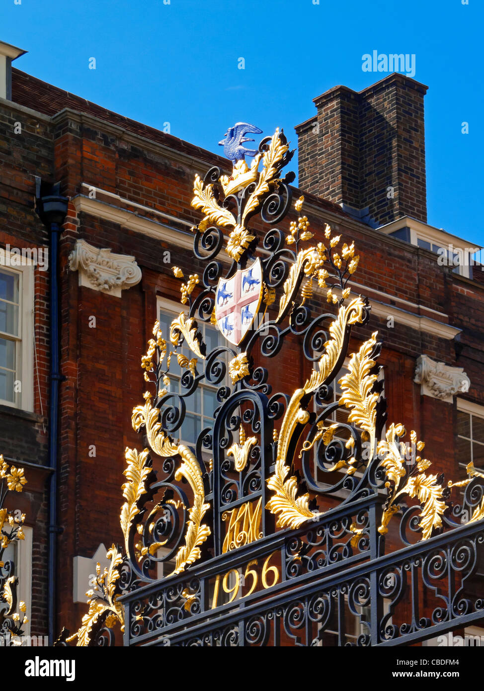 Detail of gilded heraldic entrance gates to the College of Arms in Queen Victoria Street City of London England - Stock Image