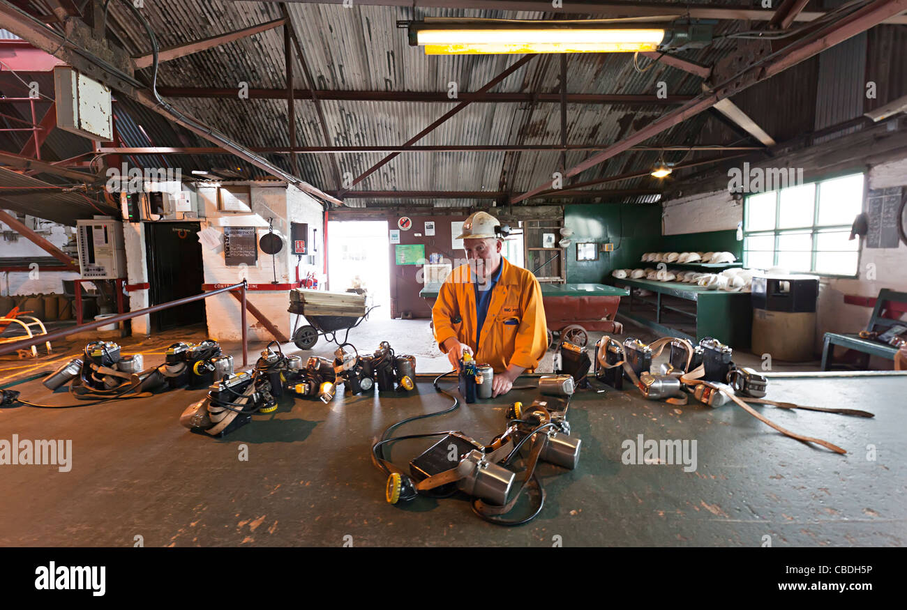 Coal miner working on lamps Big Pit Blaenavon Wales UK - Stock Image